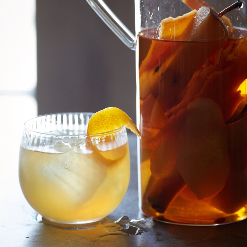 Autumn Fruit-Infused Bourbon -  Don't throw away fruit scraps like juiced citrus and the cores of apples and pears; instead, use them to make this aromatic infused bourbon.