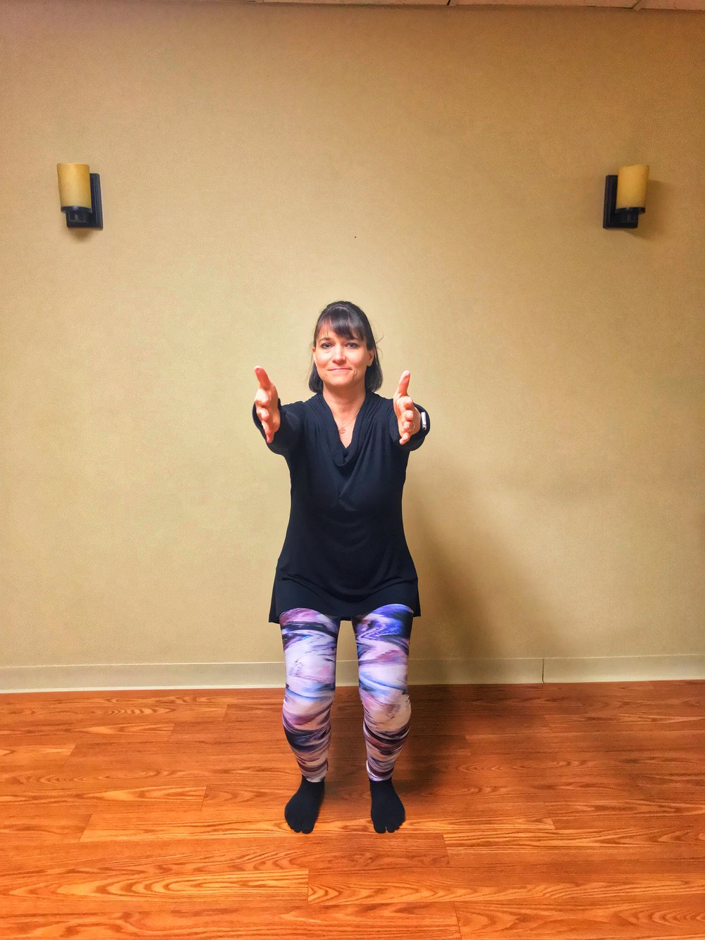 Lean forward slightly and slowly stand up. Maintain control during movement. Press your heels into the floor and tighten your buttocks as you stand to help you balance. Exhale as you stand, inhale as you sit back.