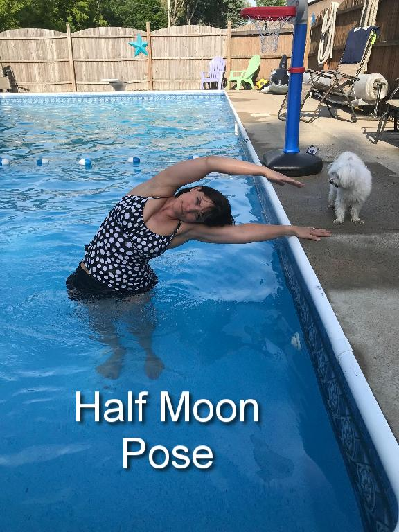 Keeping both feet planted on the ground, extend your torso into a side stretch toward the side of the pool. Hold on to the side of the pool to help with balance. Turn around and repeat with the other side.