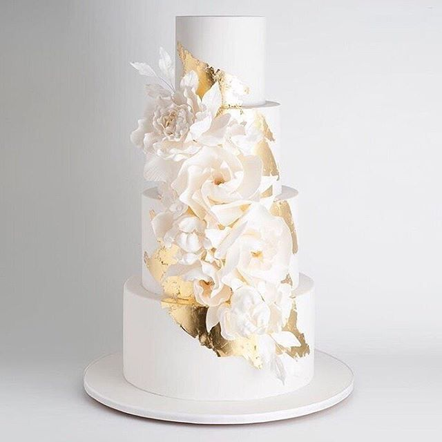 This gorgeous cake by @cake_ink via @loverly is stunning! Love the hint of gold and the floral elements. Would you like to share a bite of this cake on your wedding night with your future husband?