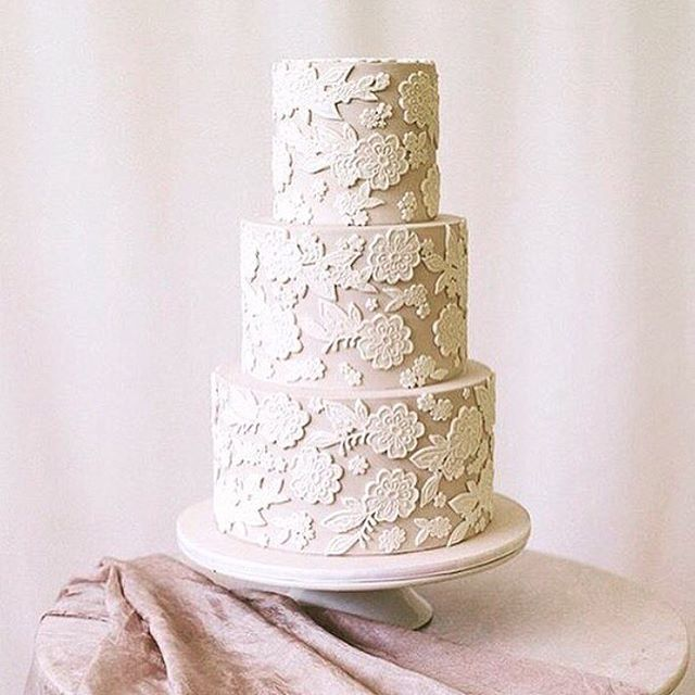 Love seeing lace as an inspiration for other aspects of the wedding. This lace cake is stunning with its light pink background. I always love a slight contrast color underneath a white lace so that the design of the lace really pops!