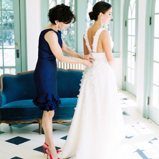 A special moment between a mother and daughter. Had the pleasure of working with both the bride and mother of the bride to create these stunning dresses. Beautiful!!