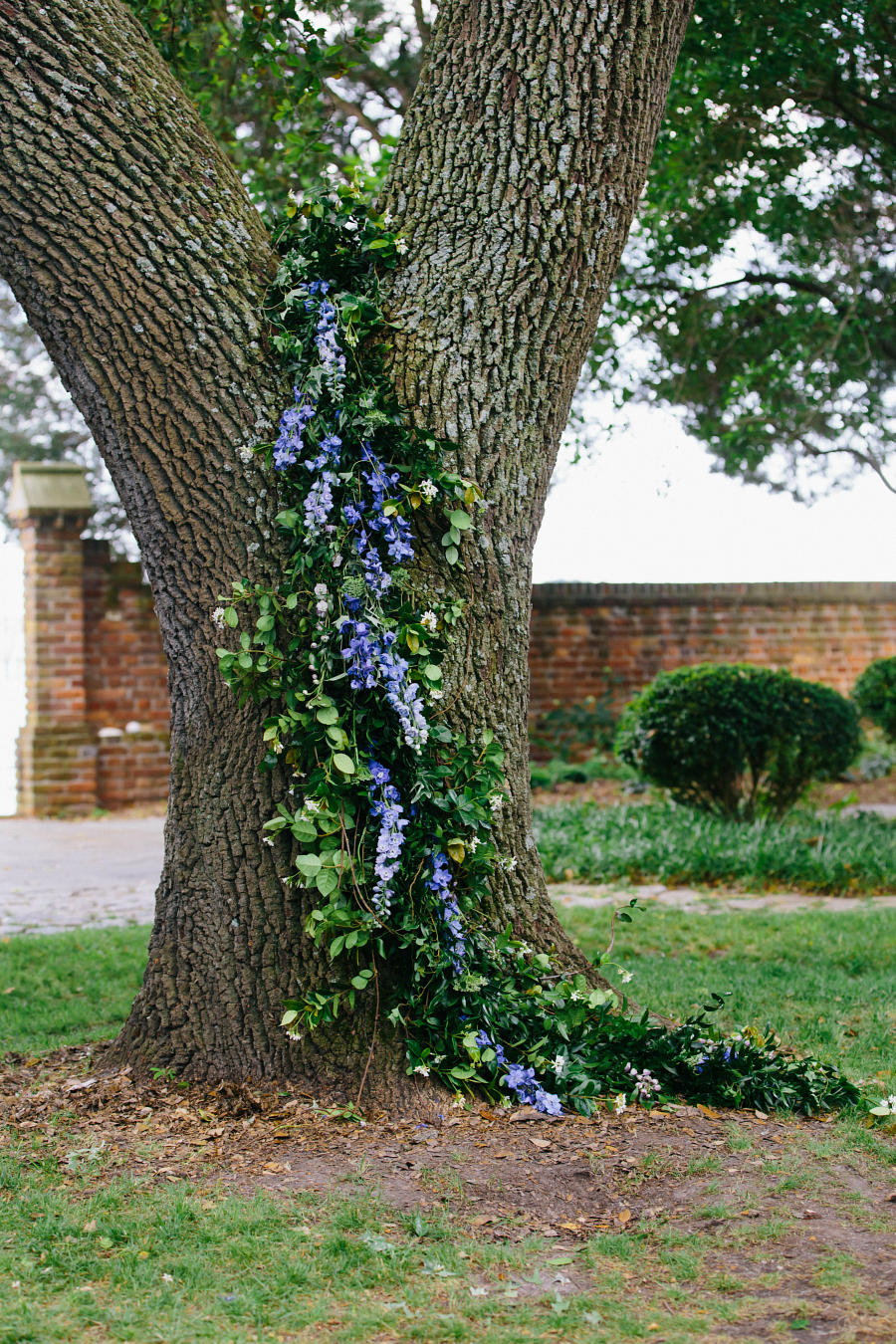 Floral draped tree for wedding ceremony