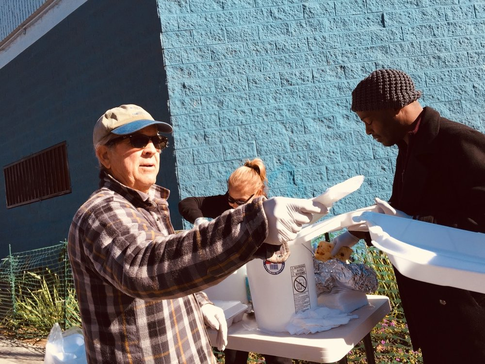 Pop Up on New Year - Though Drive-By Do-Gooders mission is to simply drive and serve water and wipes, we made an exception when we were offered enough fresh Indian food to serve hundreds on New Year's Day.We jumped at the chance, and instead of sleeping in that cold morning, volunteer dad and neighbor Jay, helped orchestrate our 2nd successful pop-up buffet.