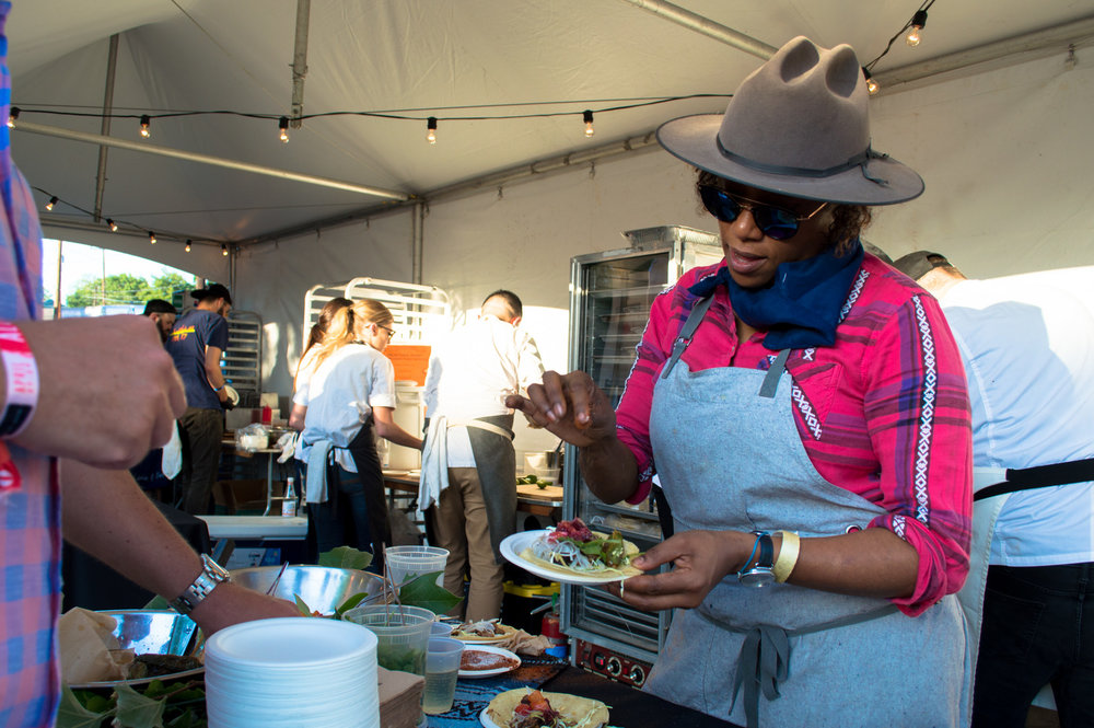 Nyesha Arrington putting the finale touches on a taco for a guest during the Rock Your Taco showcase.