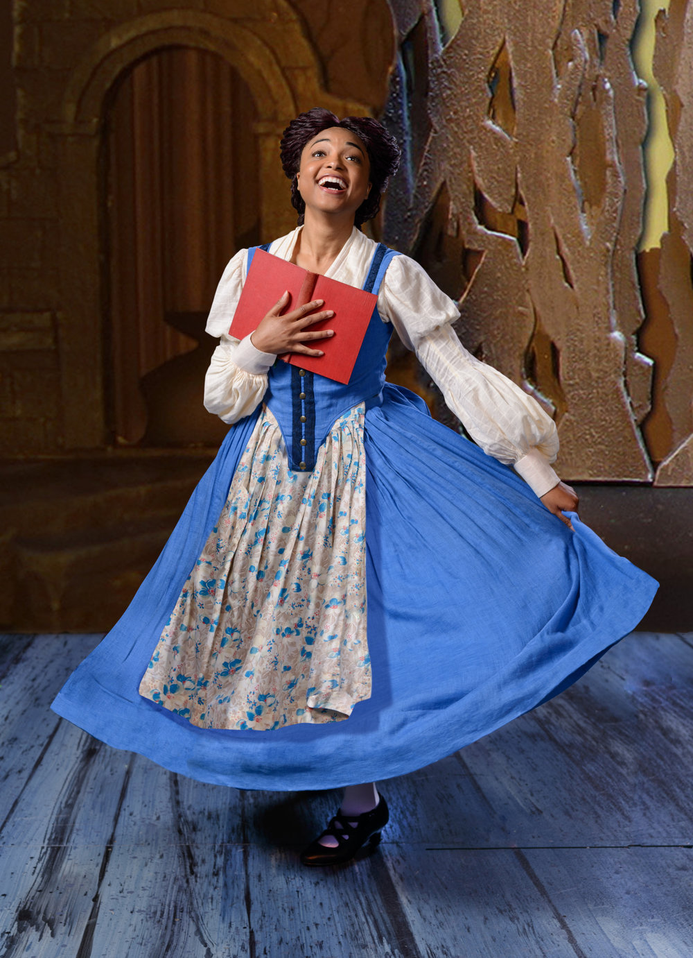 Briana Brooks as Belle in ZACH Theatre's production of Disney's Beauty and the Beast. Photos by Kirk Tuck