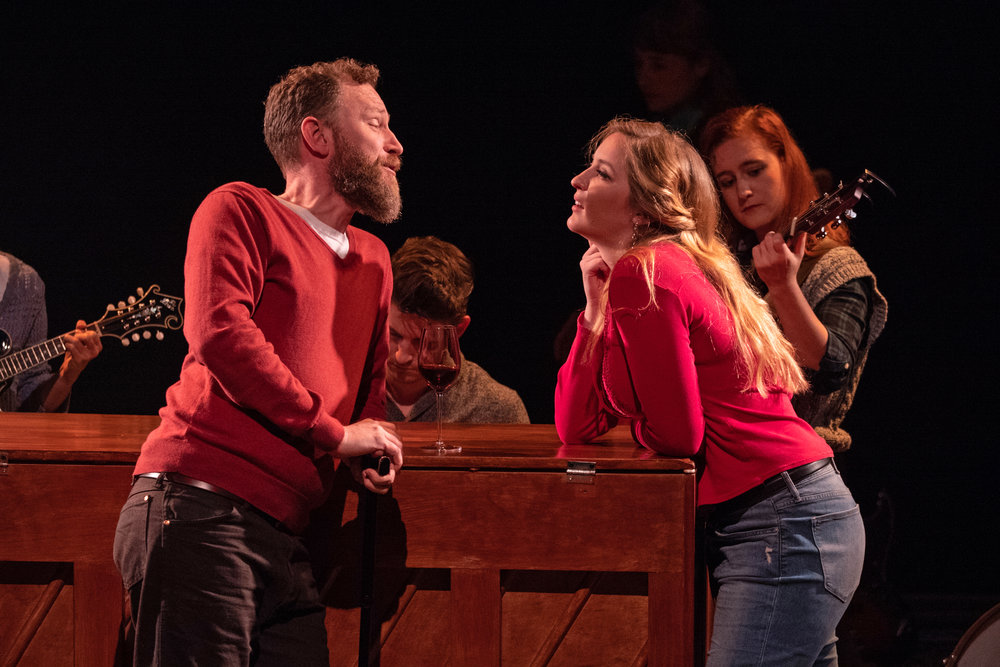 """Ben Hulan as Billy with Ginna Doyle as Reza in ZACH Theatre's production of """"Once."""" Photo by Kirk Tuck"""