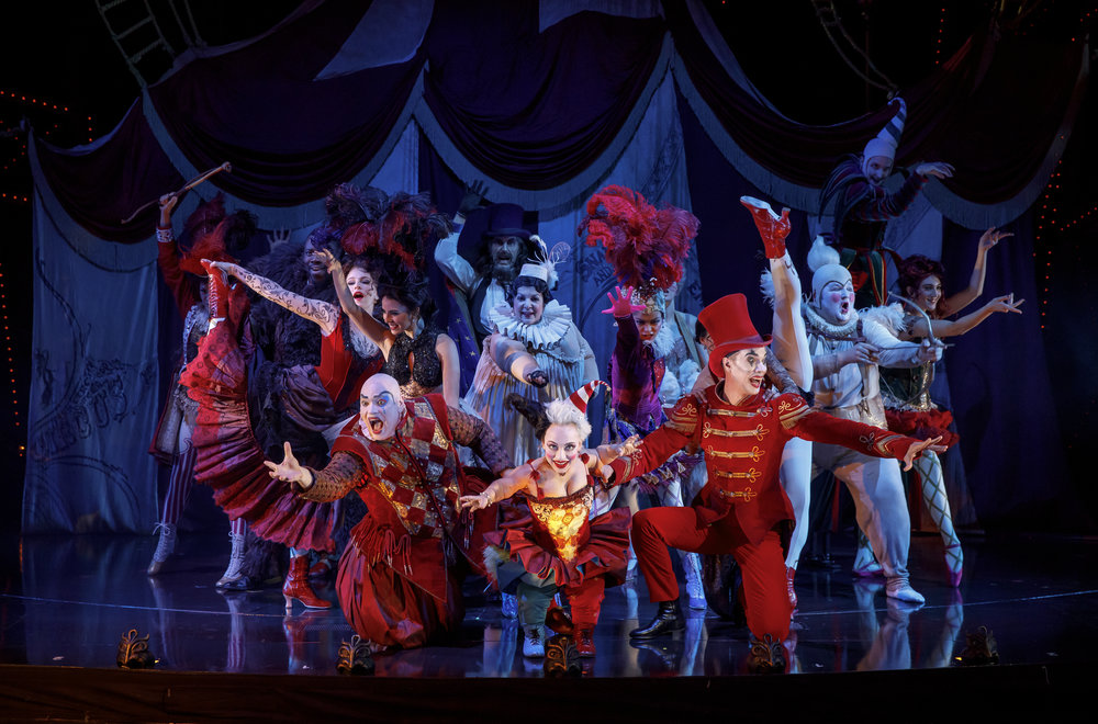 """""""The Coney Island Waltz"""" featuring Richard Koons (""""Squelch""""), Katrina Kemp (""""Fleck""""), Stephen Petrovich (""""Gangle"""") and the Ensemble of """"Love Never Dies."""" Photo by Joan Marcus."""