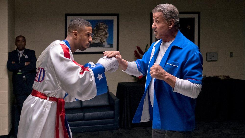 "Michael B Jordan and Sylvester Stallone in ""Creed II."""