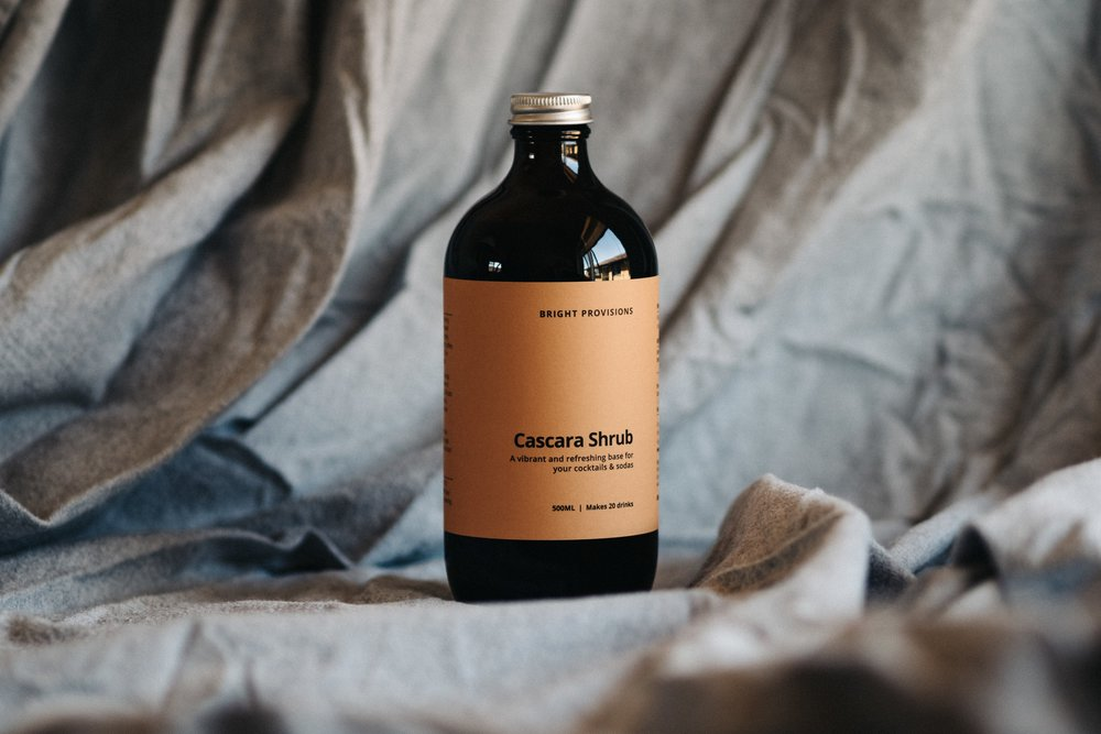 Introducing our Cascara Shrub;A vibrant and refreshing base for your cocktails & sodas. - Cascara is the husk or skin of a coffee cherry, produced when the ripe cherries are pulped before the beans are processed. Historically, Cascara has been seen as a byproduct of coffee production, and discarded or mulched. The potential for its use, though, is unlimited.