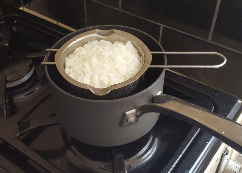 soy wax flakes over a saucepan of boiling water, on high heat.