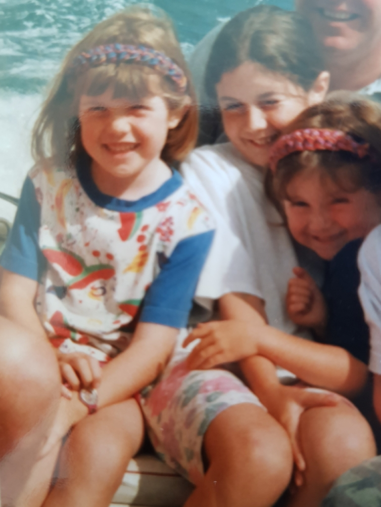 Me (left) in cornwall, about 7 years old. you can see my big, swollen knee.