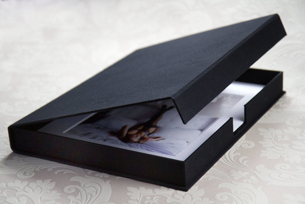 Portfolio Boxes - Made with an elegant Black linen, these boxes are simple, yet luxurious. The floor of the box is a soft, suede/velvetThe flap is kept closed with a hidden magnetStarting at 350
