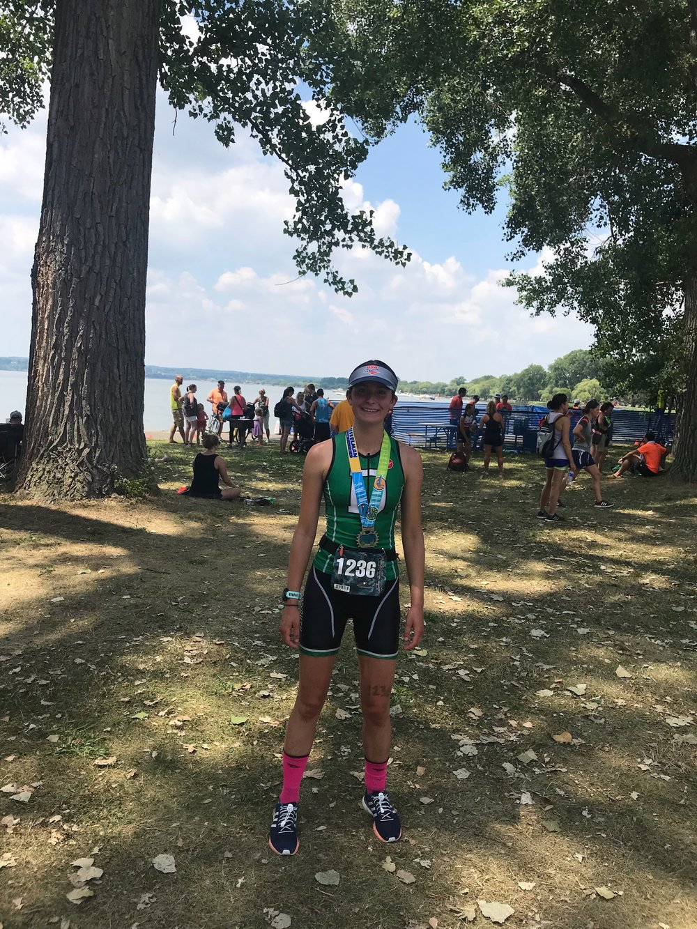 Katie, 4th overall women's finisher, at the finish line of the 2018 Musselman Triathlon.