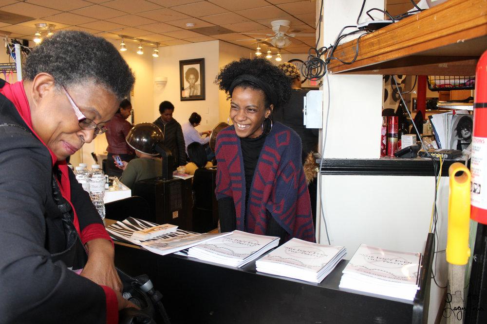 Blogger & Event Coordinator, Tatianna Samuel, enthusiastically greets an event attendee.