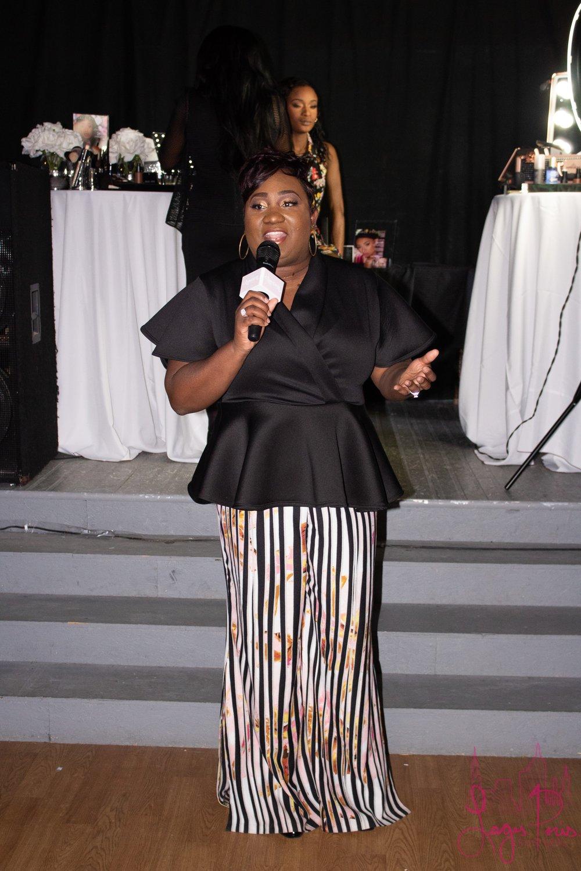 Host Katlyne Dessaint-Louis addresses event attendees.