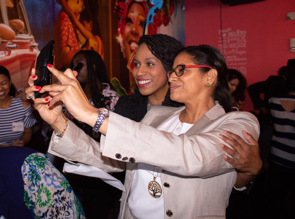 Founder, Nurys Camargo takes a selfie with Boston City Councillor, Ayanna Pressley.