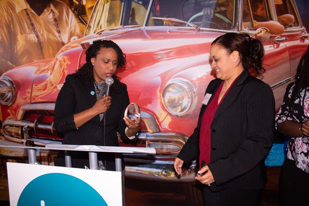 Boston City Councillor, Ayanna Pressley awards Stephanie Merritt with the Community Partnership Award.