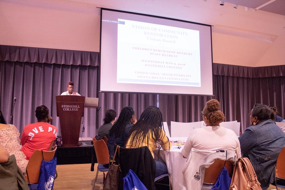 Shana Bryant addressing the Children Services of Roxbury staff during their retreat.