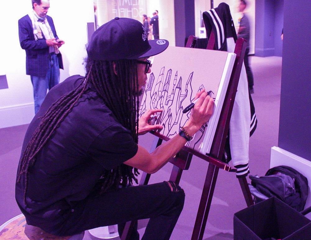 Artist Raheem Jamal fully immersed in his work.