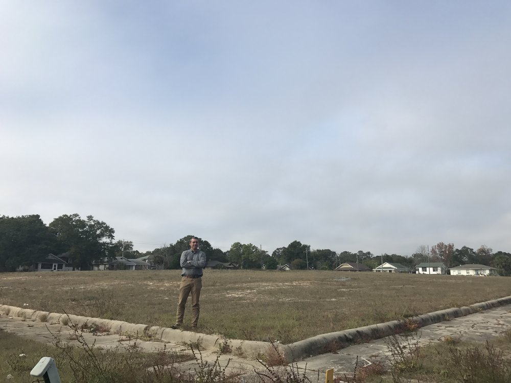 Amir Fooladi, CEO of ParsCo, poses in front of the future site of 26 new homes