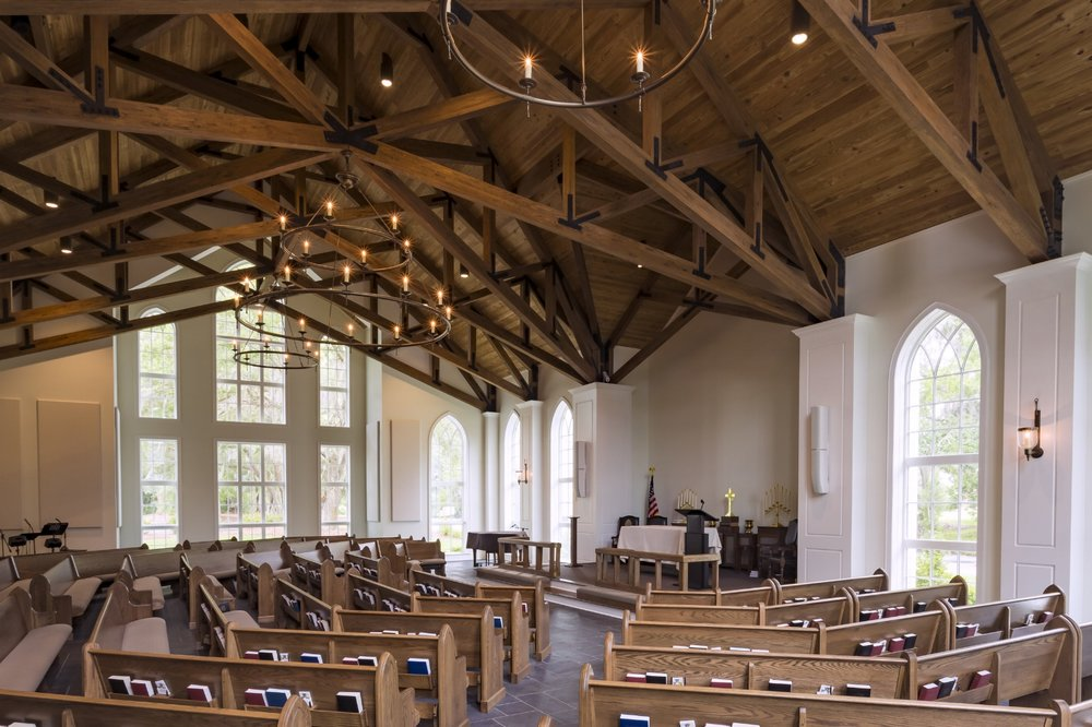 The Abbey – The pioneer of the Anglican movement in North America – The Reverend Charles Murphy – founded this parish in Pawleys Island South Carolina. The faith community purchased an unused community building and hired Blue Ridge architects to design a 220 seat chapel. The chapel was to be consistent with the architecture of low-country and capture the beauty of the surrounding Litchfield Plantation. The new chapel arranges pews around a simple platform defined by a custom altar rail. High gothic windows and heavy timber trusses give the space a timeless feel. The existing building was renovated to create a variety of fellowship, education and administrative spaces. Interior Designer and parish member Susan Albright brought an exquisite attention to detail throughout the building. Project completed in 2016