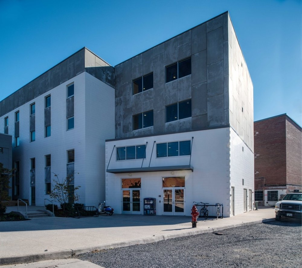 The portion of the Ice House building selected for James Madison University office space was the freezer storage, built in 1963. We added two new levels within the existing space, converted the existing loading docks to the main entrance and created vertical circulation, repurposing the space as part of a larger, dynamic mixed-use complex.