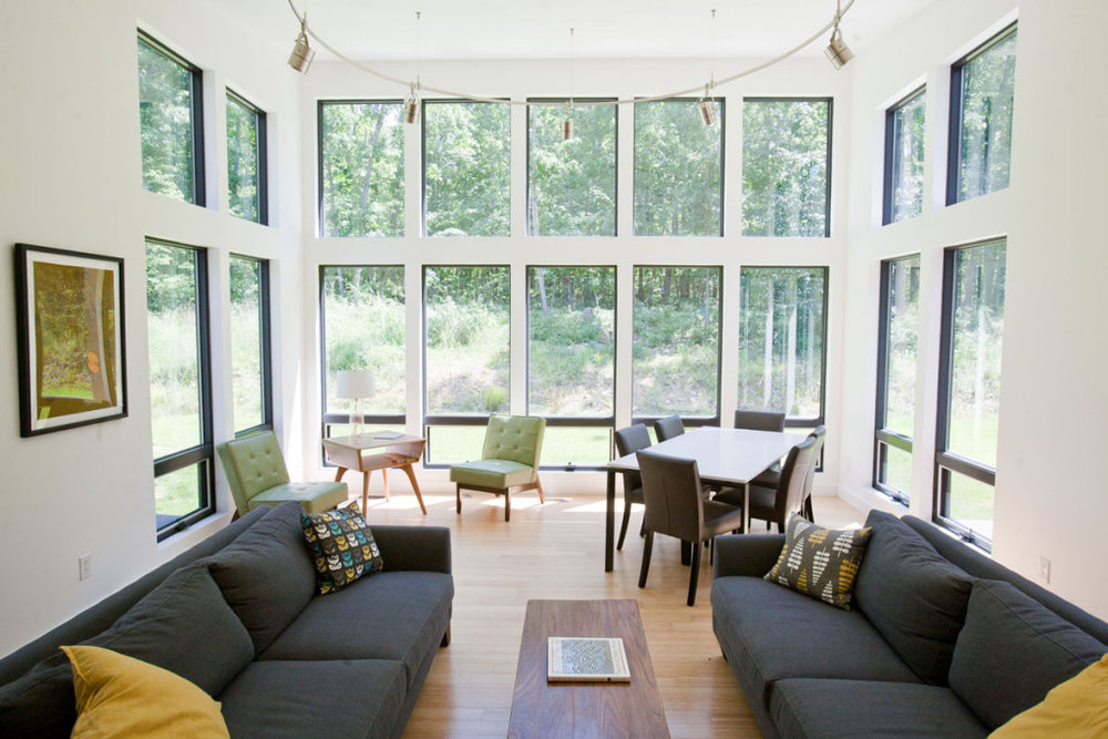 This modern retreat was designed for two busy physicians with young children. They wanted a light-filled space to enjoy their rural property and unwind from busy schedules. Blue Ridge Architects designed a modern, clean and open plan that allows for intimate family time and excellent flow for entertaining. The placement of windows allows for unobstructed views of nature and a bright, airy environment.