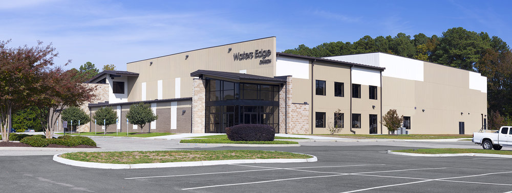 In 2008, this church in Yorktown, Virginia purchased plans on-line for their first 500 seat church. Five years later they had outgrown their church and contacted Blue Ridge Architects regarding expansion. We designed a new 1300 seat auditorium and converted the existing church into the foyer and offices for the larger worship space. Spaces for kids' ministry were also doubled. A second entry allowed people to move more directly from the parking lot into the foyer.