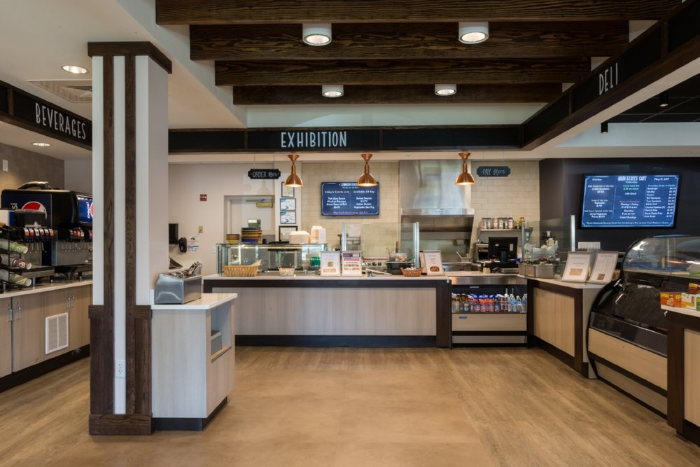 The café on the Main Street of Park Gables at VMRC had remained unchanged from 1999 when it opened. VMRC food service came to Blue Ridge Architects with the goal of creating a more retail/ less cafeteria feel, provide space for more food offerings, expand seating and create an exhibition space for made-to-order food. Blue Ridge worked with VMRC's restaurant consultant and sorted the complex mechanical and electrical changes needed to support the new layout.  Project opened in 2016.
