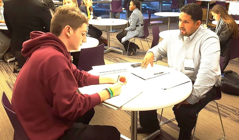 Ian Pineda assisting students through practice interviews  Suffolk University Alumni Board of Directors