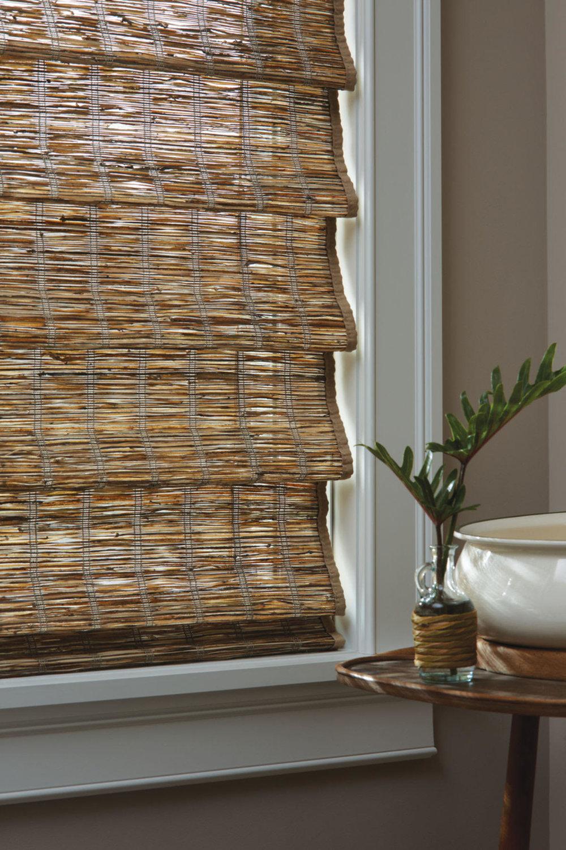 Lauras Draperies and Blinds Little Rock Arkansas Silhouettes Shades Custom Bedding Curtains woven wood shades 5.jpg