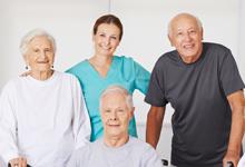 3 seniors posing with a nurse.