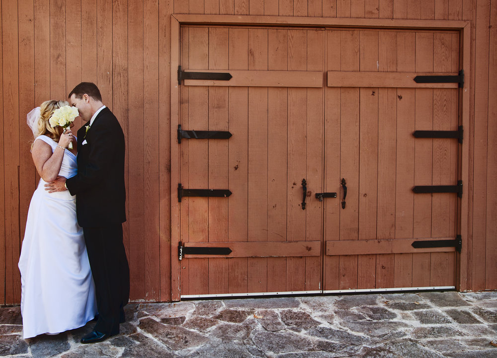 newlyweds-portrait-barn-door.jpg