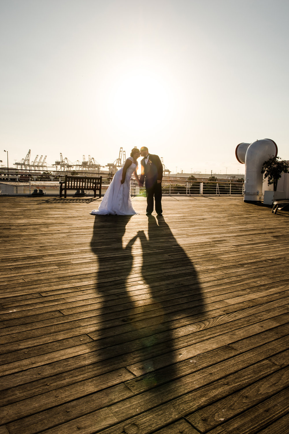 bride-groom-kiss-long-shadow.jpg
