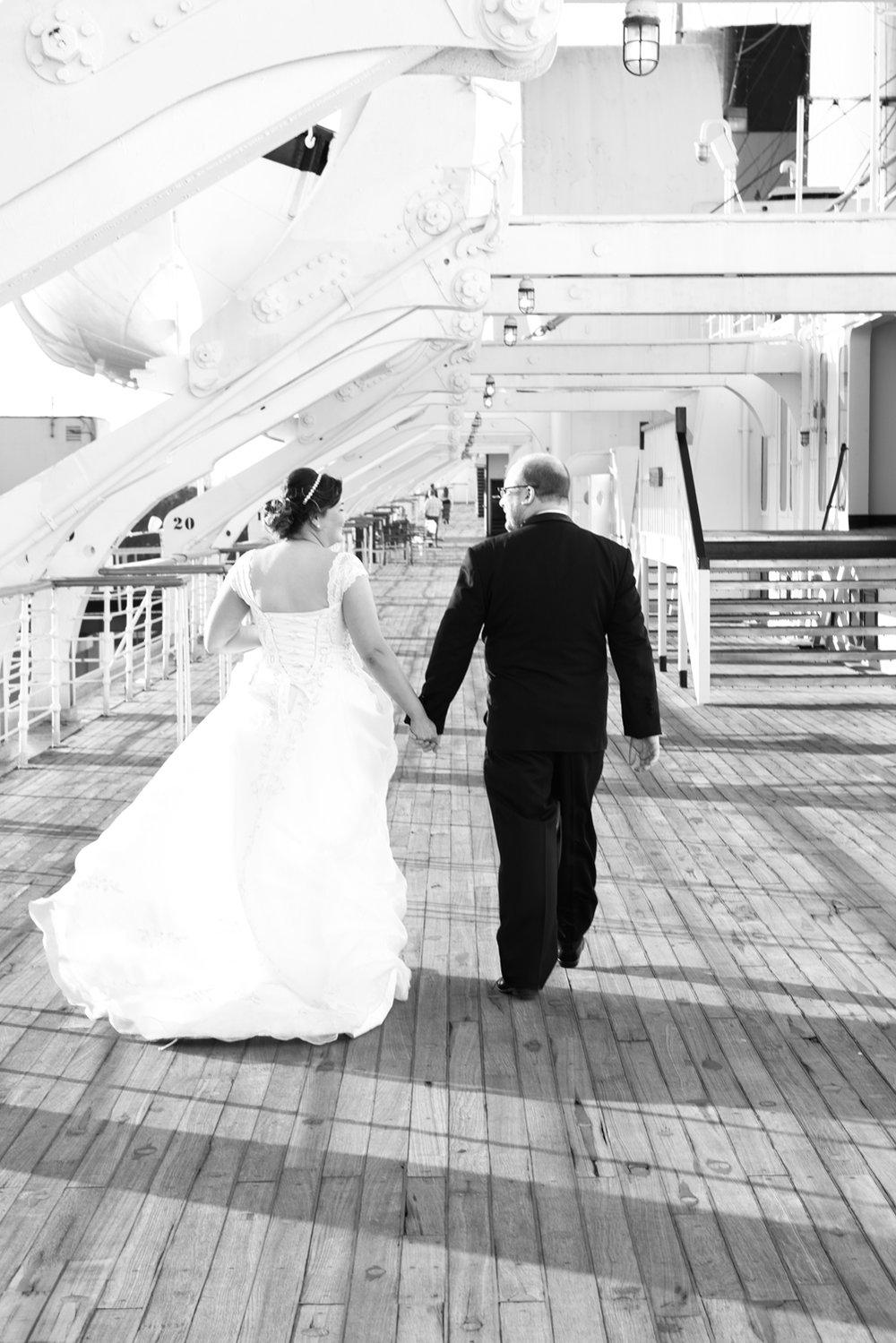 bride-groom-walking-queen-mary.jpg