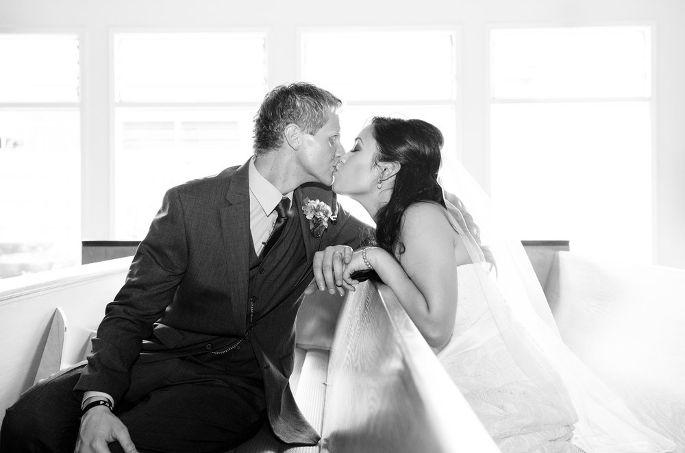 bride-groom-portrait-kiss-church.jpg