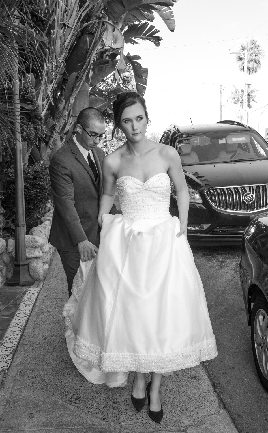 bride-walking-sidewalk-black-white.jpg