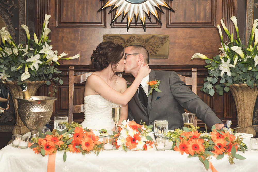 bride-groom-kissing-table.jpg