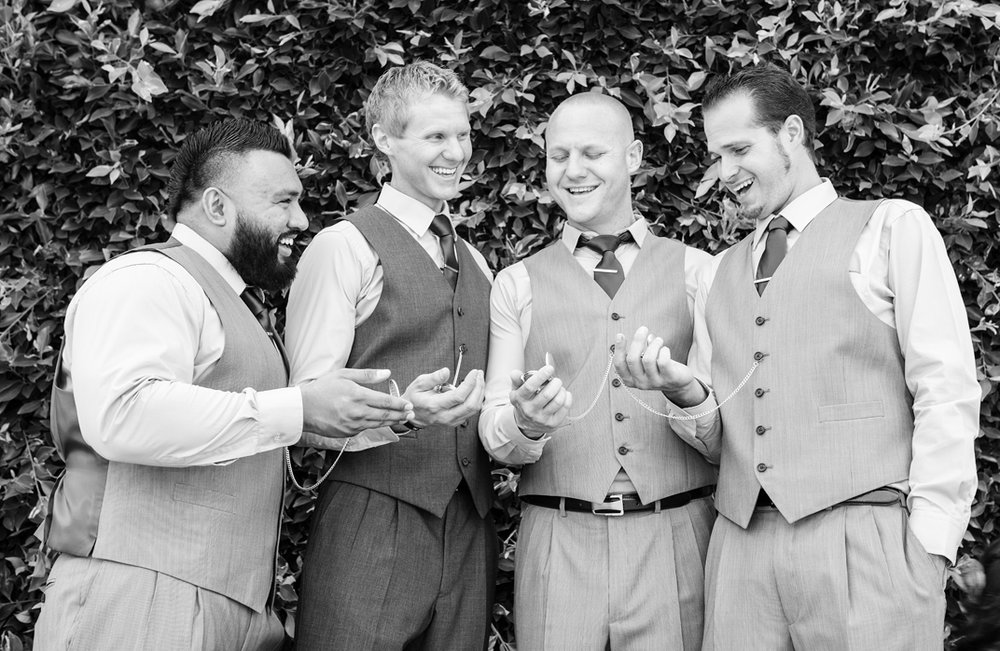 groomsmen-showing-watches.jpg
