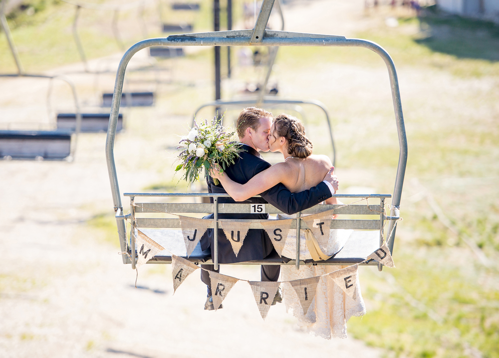 bride-groom-ski-lift-kissing-facebook.png
