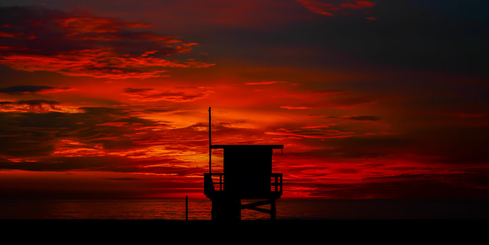 sunset-lifeguard-tower-red-sky-silhouette.jpg