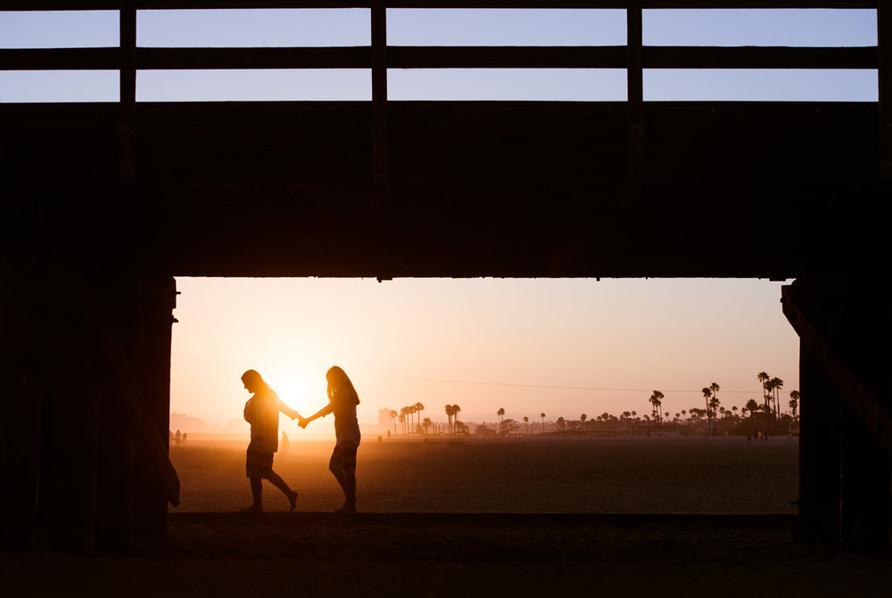 engagement-couple-beach-holding-hands-silhouette.jpg