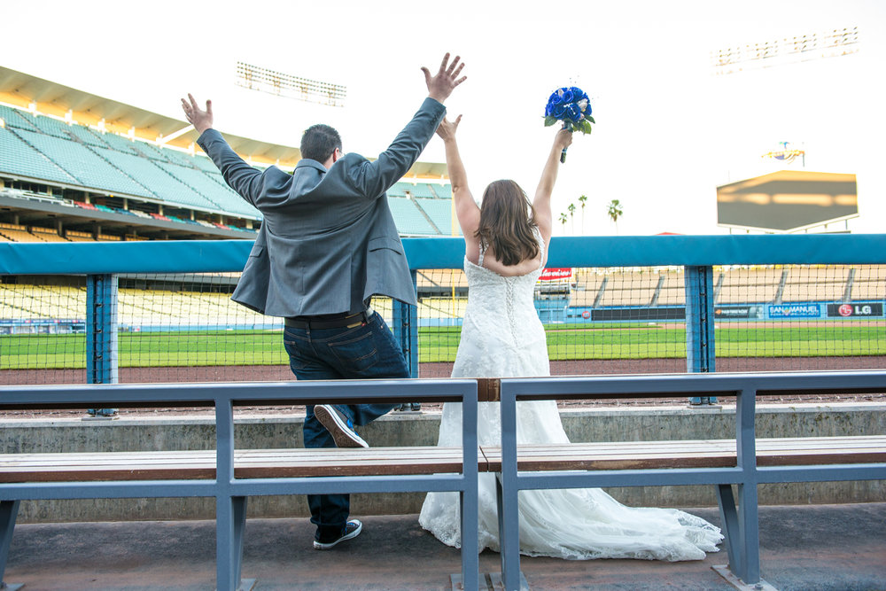 bride-groom-cheering-dugout-dodger-stadium copy.jpg