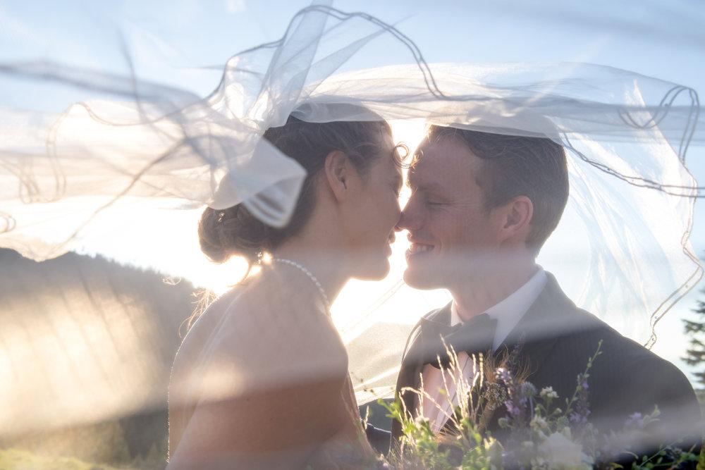 bride-groom-portrait-kissing-vail.jpg