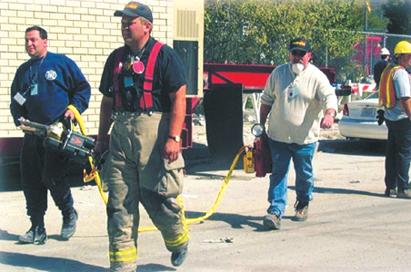 Frankie Borgesi, Charlie Miller and Harold Garner delivering a Power Hawk to a Task Force Rescue Team at Ground Zero