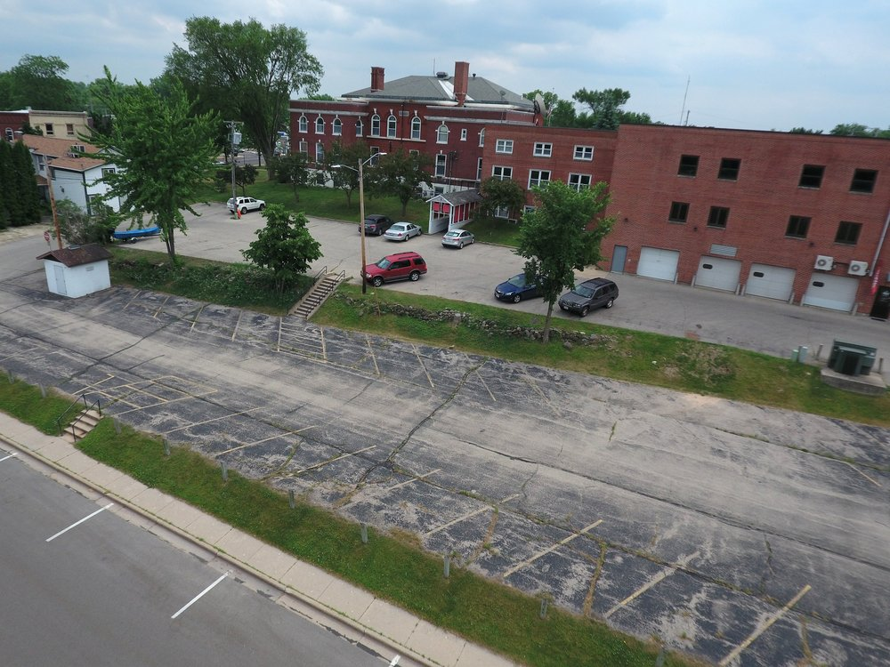 Current state of the back lot where the Mill Pond Terrace will soon be contructed..jpg