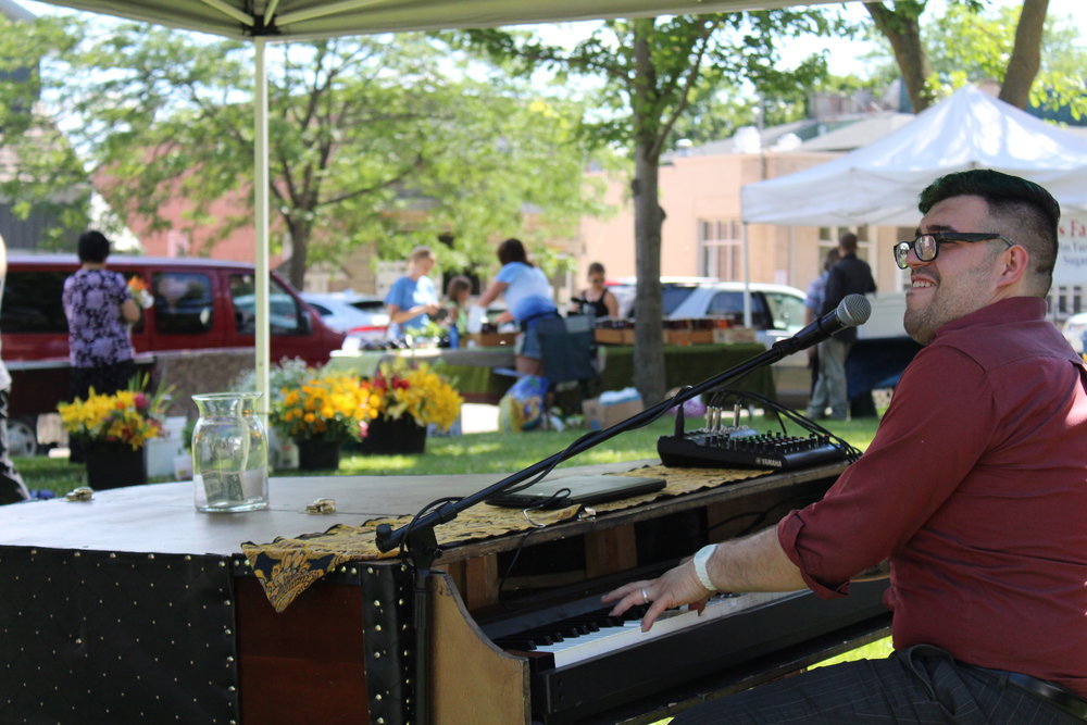 Tha Market kicks off Friday, May 25 with an energetic performace by Anthony Lux and his famous pleather piano.
