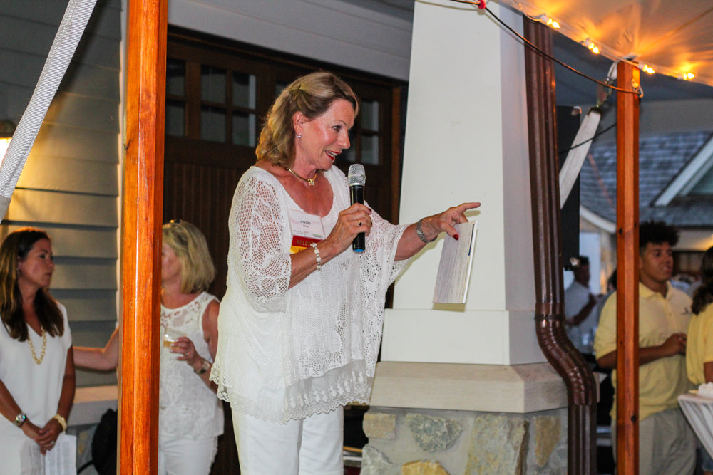 Event Chair Joan Lloyd welcomes a crowd of more than 400 Green Lake community donors to Green Lake Renewal's White Hot Party.