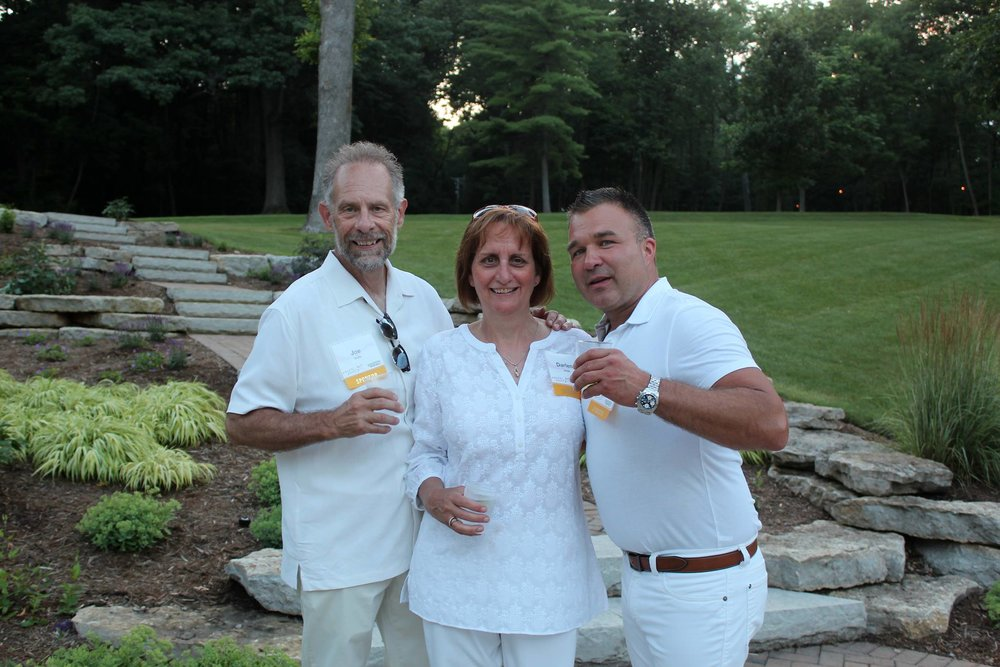 White Hot Party Sponsors Joe and Darlene Holik of Sign Palace and Jeff Shadick of Special Properties toast the future of Green Lake.